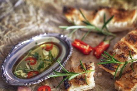 mediterranean culture: Ciabatta bread with olive oil and rosemary