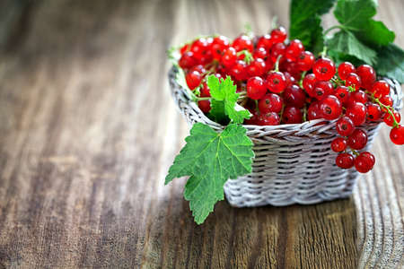 red currant: Ripe red currant on wooden background with copy space Stock Photo