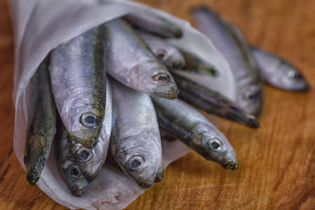 sardines: Fresh sardines on wooden table