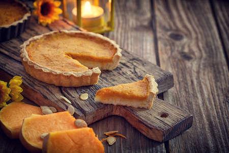 Thanksgiving pumpkin pie on wooden background