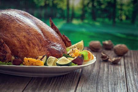 Thanksgiving Turkey dinner - outdoor wooden table Stock Photo