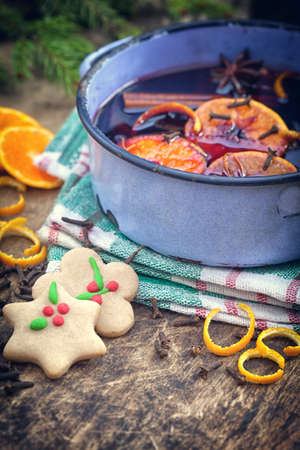punch spice: Mulled wine with spices and ingredients on wooden background