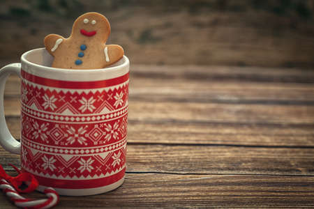 Christmas Gingerbread cookies with mug on wooden background with copy space