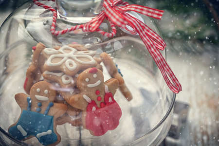 Christmas Gingerbread cookie on glass stand with snow flakes Stock Photo