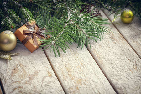 Christmas garland on rustic white wooden table with copy space