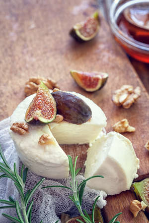 Ricotta with ripe sliced fig fruits, nuts and honey