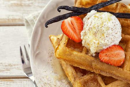 Waffles with Fresh Strawberries and Vanilla ice cream