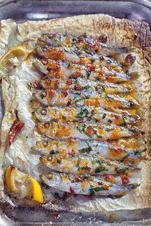 Grilled sardines on baking sheet