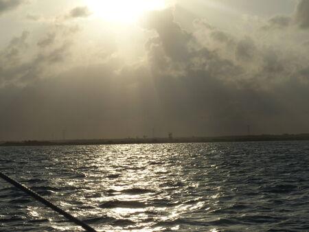 Sundown over the Cancun ocean on a cloudy day