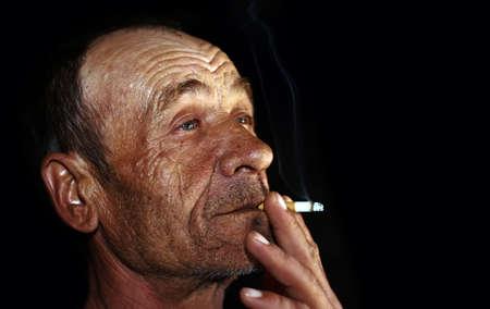 man smoking: old man smoking Stock Photo