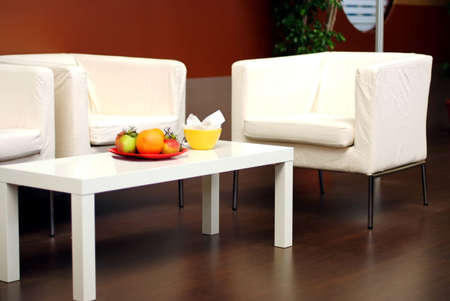 White sofas with fruits on the table, modern design Stock Photo - 2080061
