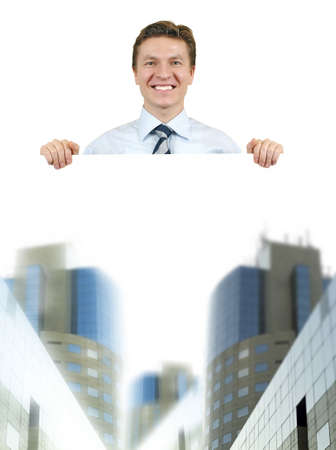 Business man holding a white board with corporate buildings , top of the world photo