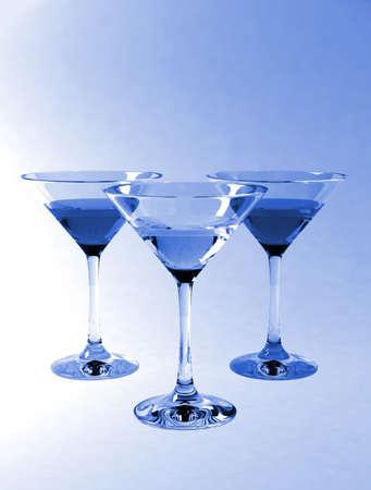 solemnize: Martini glasses isolated on blue background