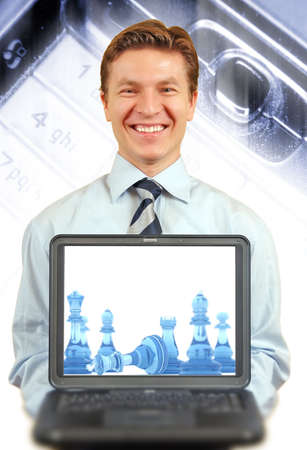 Young businessman presenting a laptop , cell keyboard in macro and light streaks on the background photo
