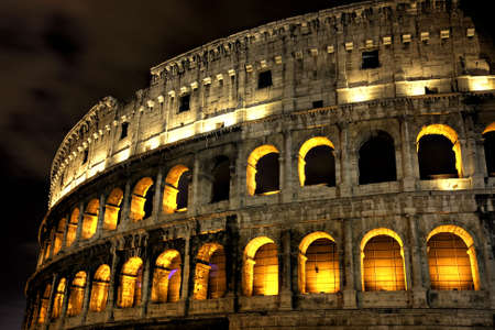 Illuminated Coliseum at night, HDR version, Rome, Italy photo