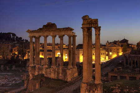 Blue hour at the Forum Romanum with temple of Saturn and of Vespasian and Titus, Rome, Italy photo