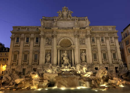 neptun: Illuminated Fontana Di Trevi at the blue hour, Rome Stock Photo