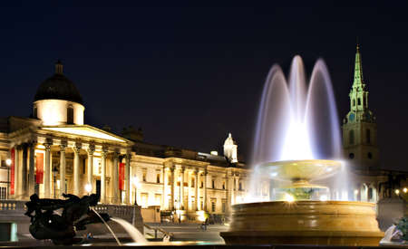 Illuminated Trafalgar Square at night with Fountain, London, England