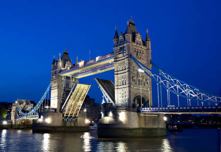 The Tower Bridge with open drawbridge during the Blue Hour, London, England