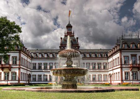 Main Facade of Schloss Philippsruhe with fountain, Hanau, Germany Stock Photo