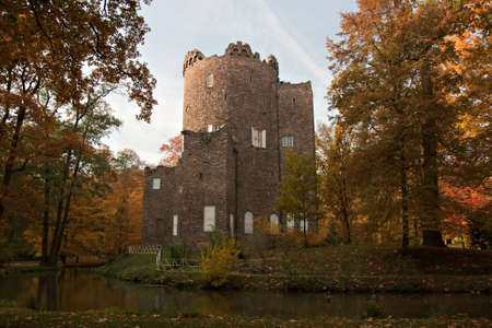 Ruined Castle in Autumn, Park Wilhelmsbad, Hanau, Germany Stock Photo