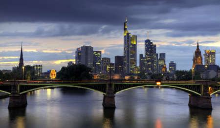 Frankfurt skyline at dusk with Ignatz Bubis bridge, Frankfurt, Hessen, Germany photo