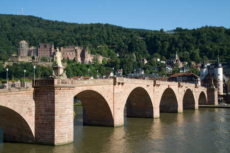 Old Bridge over the river Main with the red castle in the background, Heidelberg, Germany photo