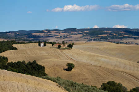 Lonely chapel surrounded by fields in Valley Orcia, Tuscany, Italy photo