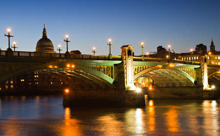 southwark: Illuminated Southwark Bridge at the blue hour, London, England