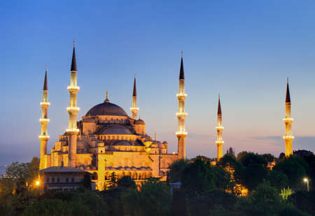 Illuminated Sultan Ahmed Mosque during the blue hour in HDR, Istanbul, Turkey photo