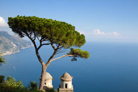 Amalfi coast as seen from Ravello with a tree and a church in the foreground, Revello, Italy