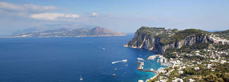 Panorama of Capri with Sorrent coastline in the distance, Campania, Italy
