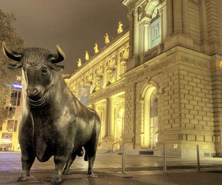 money exchange: Bull sculpture at night, Stock exchange, Frankfurt, Germany Stock Photo