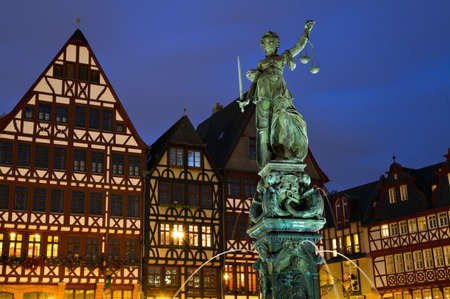 Medieval Timberframe houses and Lady Justice. Frankfurt, Germany