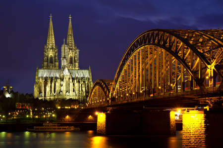 Cityscape of Cologne at twilight with the cathedral and Hoherzollern bridge