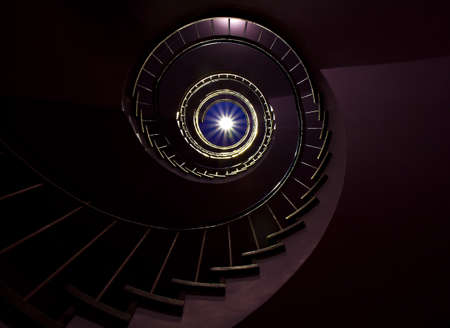 Dark Spiral staircase moving towards the light Stok Fotoğraf