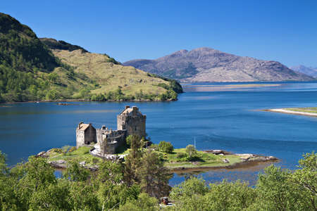 highland: Eilean Donan Castle under a blue sky, Scotland, Europe