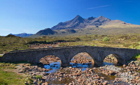 Stone bridge over a small river, Isle of Skye, Scotland Stock Photo
