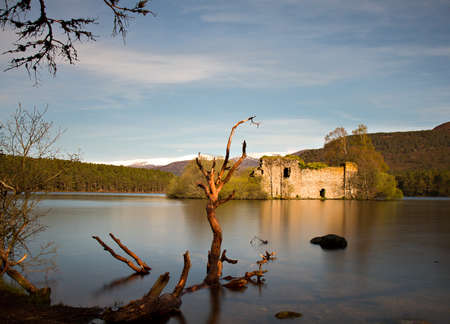 Loch an Eilean castle - Long exposure version, Aviemore, Scotland Stock Photo