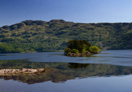 Small island on Loch Lomond, Scotland, United Kingdom photo