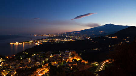 Panorama of Giardini-Naxos and Etna at twilight, Sicily, Italy