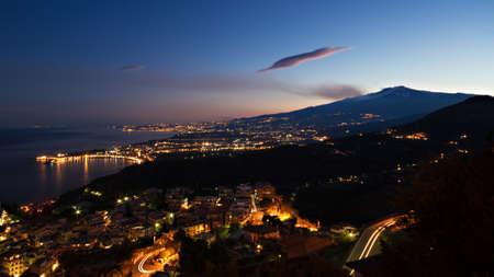 Panorama of Giardini-Naxos and Etna at twilight, Sicily, Italy
