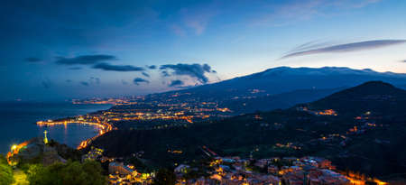 Panorama of Giardini-Naxos and Etna at dusk Stock Photo