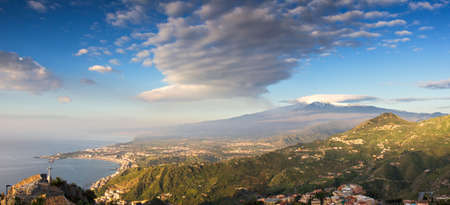 Panorama of the Etna and the sicilian coastline, Italy photo