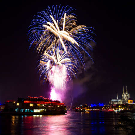 Blue fireworks over Cologne with the famous cathedral, Germany Stock Photo
