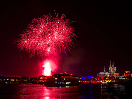 Red fireworks over Cologne with the famous cathedral, Germany photo