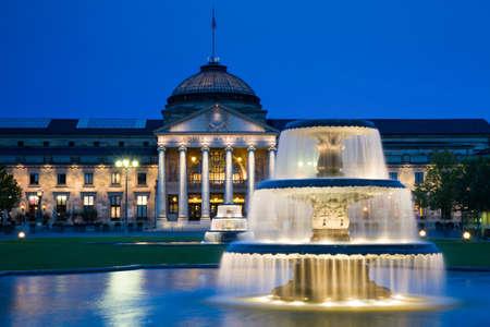 hessen: Kurhaus Wiesbaden with fountains at twilight, Hessen, Germany Editorial