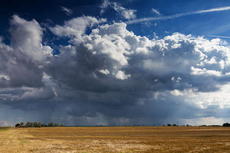 Thundercloud over a cropped field, Wetterau, Germany Stok Fotoğraf