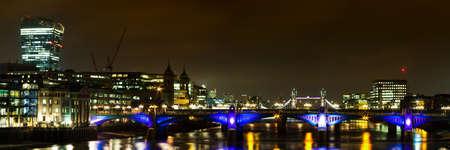southwark: Panorama of Southwark bridge towards Tower bridge at night, London, England Editorial