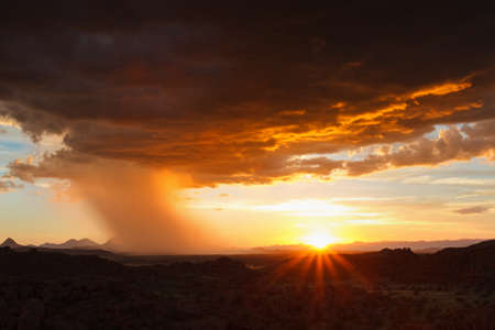 Thunderstorm approaching in the desert at sunset, Namibia Stock Photo